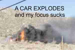 Burning house explodes car