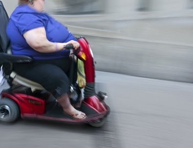 Fat woman on scooter